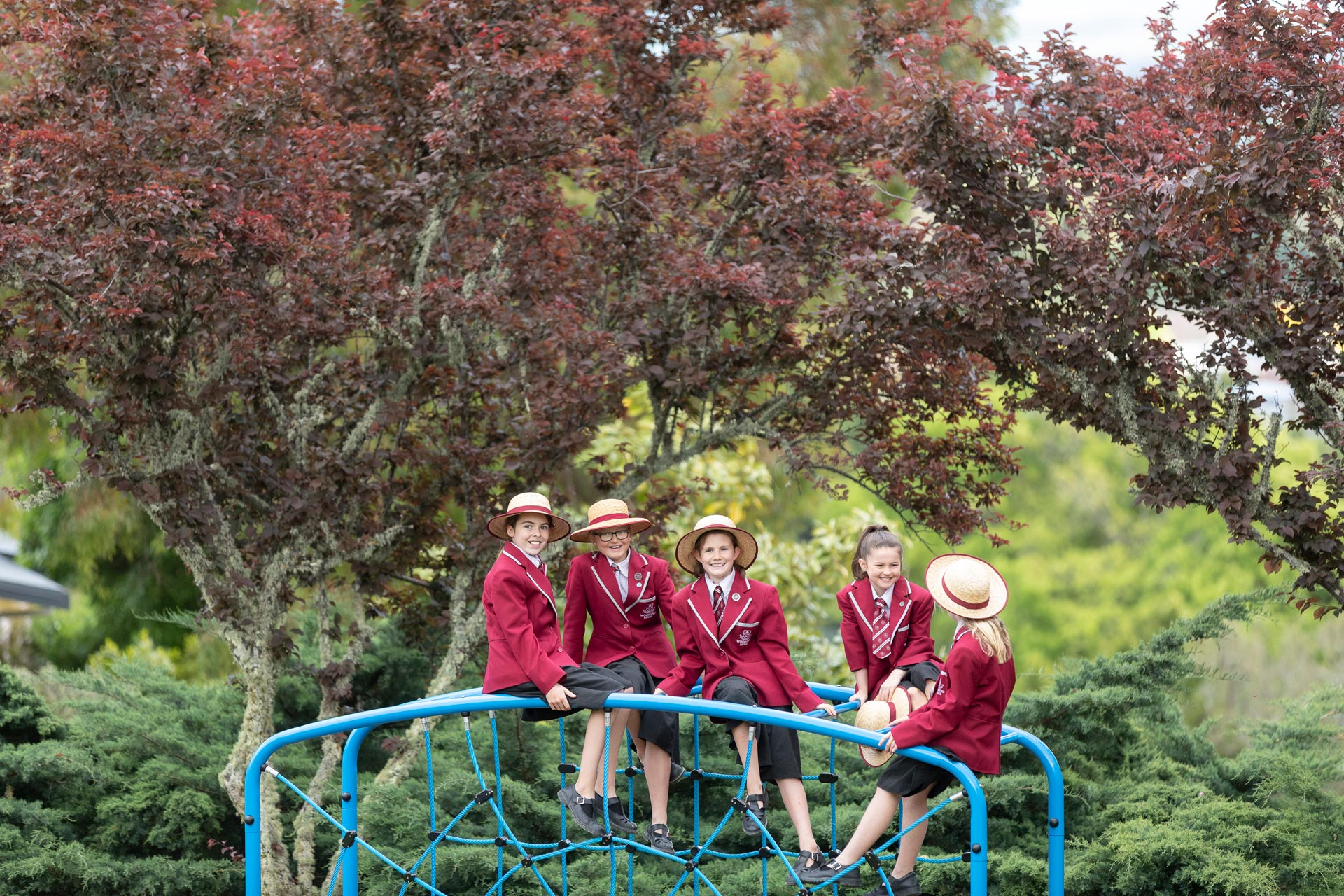 5 Woodford students on a playground